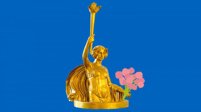 Golden angel statue holding a flower bouquet