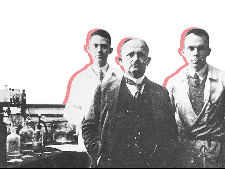 Hans Fischer and students in the laboratory